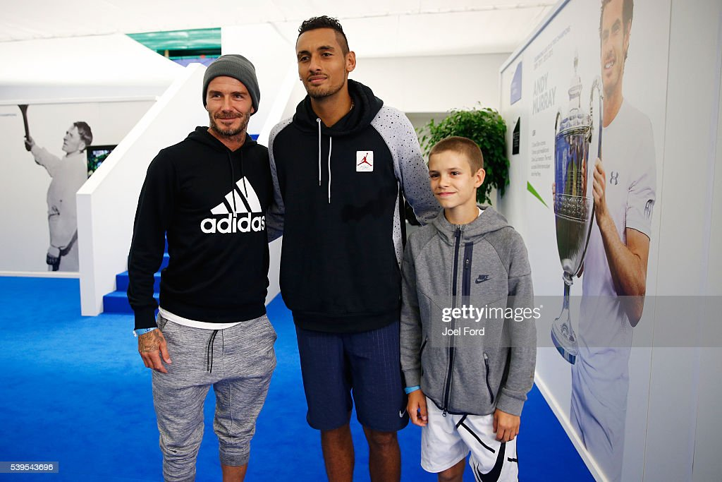 Former footballer David Beckham (L) and his son Romeo pose for a picture with tennis player Nick Kyrgios at the Aegon Championships at Queens Club on June 12, 2016 in London, England.