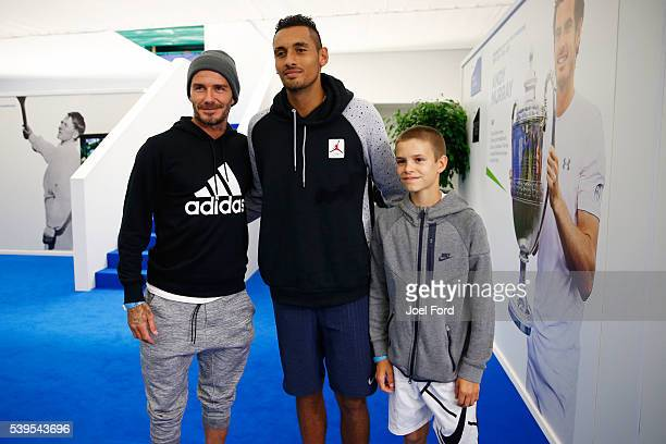 Former footballer David Beckham and his son Romeo pose for a picture with tennis player Nick Kyrgios at the Aegon Championships at Queens Club on...