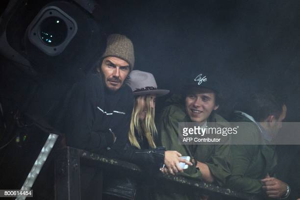 Former footballer David Beckham watches The Foo Fighters perform on the Pyramid Stageduring the Glastonbury Festival of Music and Performing Arts on...