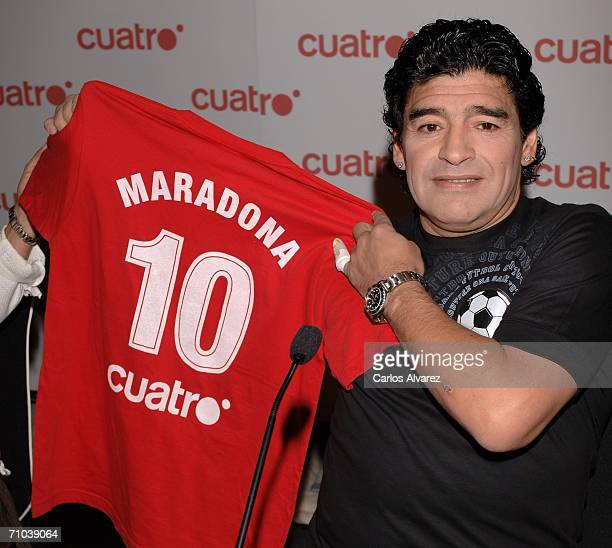 Former footballer Diego Maradona holds a shirt as he attends a media conference at the Mirasierra Suit Hotel on May 24, 2006 in Madrid, Spain....