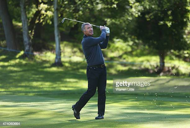 Former footballer Graeme Souness hits an approach during the ProAm ahead of the BMW PGA Championship at Wentworth on May 20 2015 in Virginia Water...