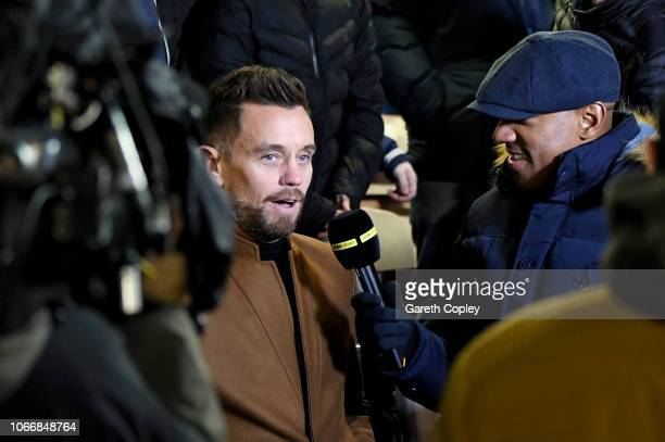 Former footballer Lee Hendrie is interviewed by Dion Dublin before the FA Cup Second Round match between Solihull Moors and Blackpool at Damson Park...