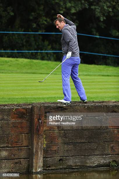 Former footballer Matt Le Tissier plays out of trouble on the 18th hole during the ProAm prior to the BMW PGA Championship at Wentworth on May 25...