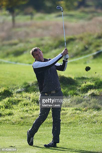 Former footballer Matthew Le Tissier plays his second shot shot on the 14th hole during the Hero ProAm at The Grove on October 12 2016 in Watford...