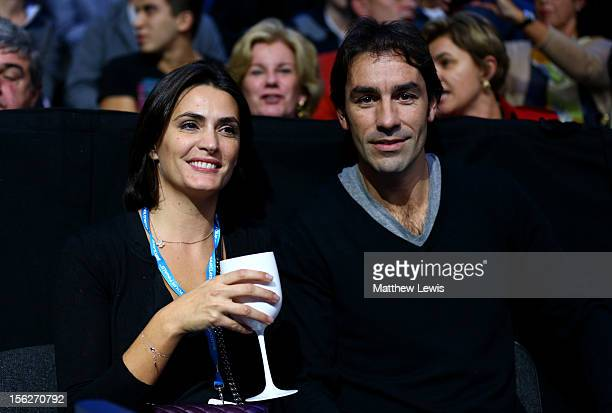 Former footballer Robert Pires and wife wife Jessica Lemarie attend the men's singles final match between Roger Federer of Switzerland and Novak...