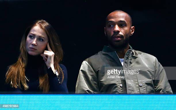 Former footballer Thierry Henry and his girlfriend Andrea Rajacic attend the men's singles final between Roger Federer of Switzerland and Novak...
