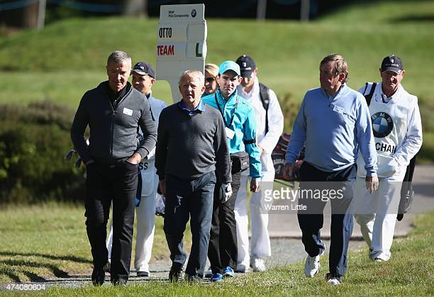 Former Footballers Graeme Souness Gordon Strachan and Kenny Dalglish walk together during the ProAm ahead of the BMW PGA Championship at Wentworth on...