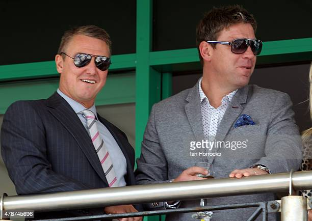 Former footballers Lee Clark and Alan Thompson watch the racing during The Northumberland Plate Meeting at High Gosforth Park on June 27 2015 in...