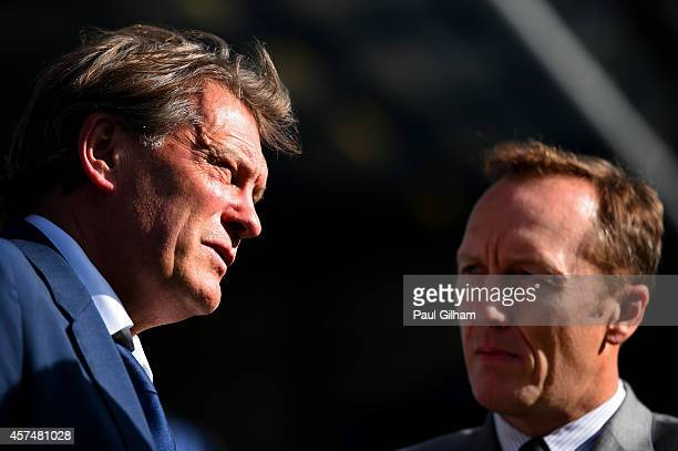 Former footballers Lee Dixon and Glenn Hoddle speak before the Barclays Premier League match between Queens Park Rangers and Liverpool at Loftus Road...