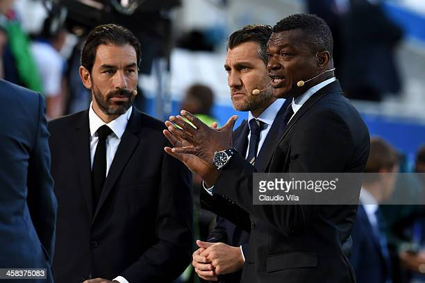 Former footballers Robert Pires Christian Vieri and Marcel Desailly are seen prior to the UEFA EURO 2016 quarter final match between Germany and...