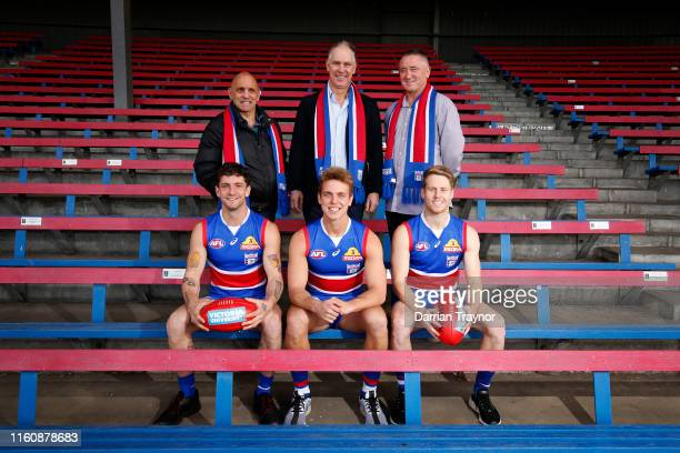 Former Footscray players Tony Liberatore Steve Wallis and Mark Hunter pose for a photo with their sons and current Western Bulldogs players Tom...