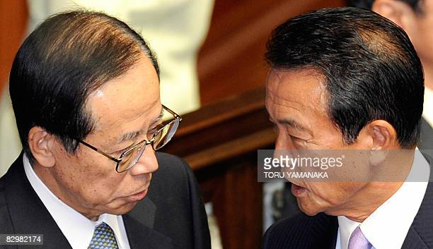 Former foreign minister Taro Aso chats with outgoing prime minister Yasuo Fukuda before Aso is appointed as new prime minister to succeed Fukuda at...