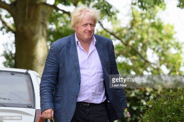 Former Foreign Secretary Boris Johnson arrives at his home on September 10 2018 in Thame England