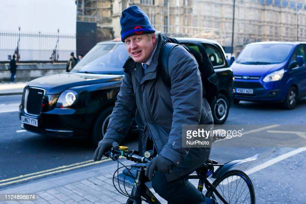 Former Foreign Secretary Boris Johnson MP rides his bicycle as he mahes his way to the Parliament London on February 14 2019 MPs are set to debate...