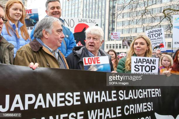 Former Foreign Secretary Boris Johnson's girlfriend Carrie Symonds with Boris Johnson's father Stanley Johnson are seen holding placards during the...