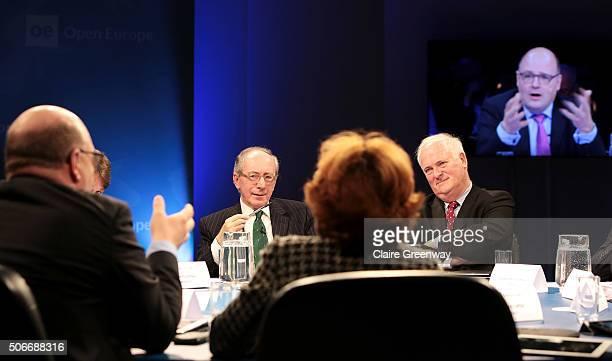 Former Foreign Secretary, Sir Malcolm Rifkind, KCMG, QC and former Taoiseach of Ireland, John Bruton listen as former Deputy Finance Minister of...