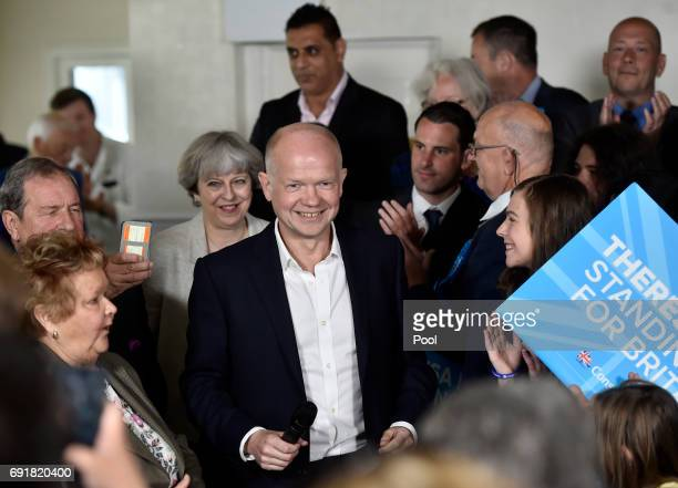 Former Foreign Secretary William Hague sand Britain's Prime Minister Theresa May attend an election campaign event during a visit to West Yorkshire...