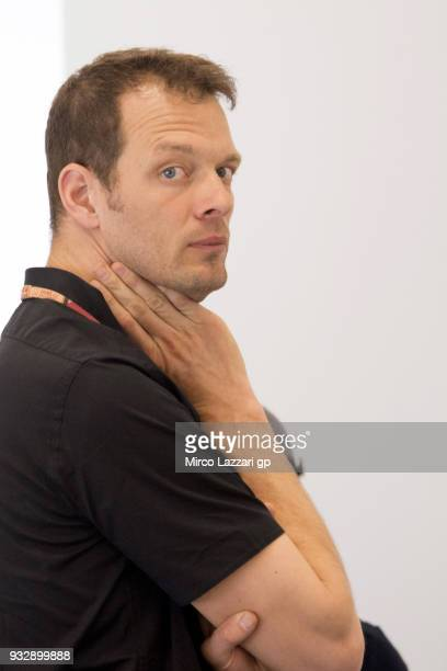 Former Formula 1 driver Alexander Wurz of Austria looks on in the media center during the MotoGP of Qatar - Free Practice at Losail Circuit on March...