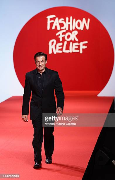 Former Formula 1 driver Jean Alesi walks the runway at Fashion For Relief at Forville market during the 64th Annual Cannes Film Festival on May 16...