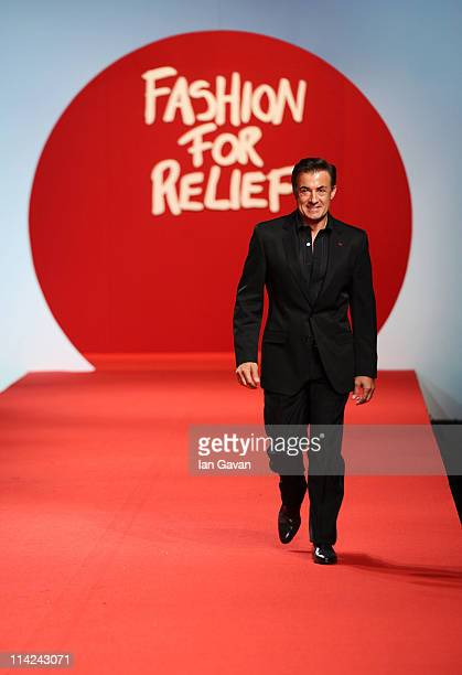 Former Formula 1 driver Jean Alesi walks the runway at the Fashion For Relief at Forville market during the 64th Annual Cannes Film Festival on May...
