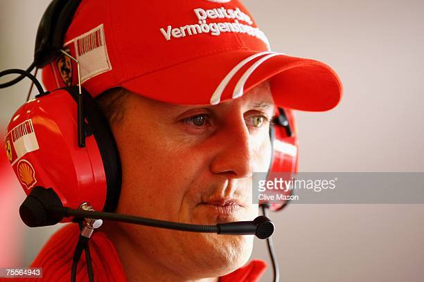 Former Formula One Champion Michael Schumacher of Germany and Ferrari looks on from the pits during practice for the European Grand Prix at...