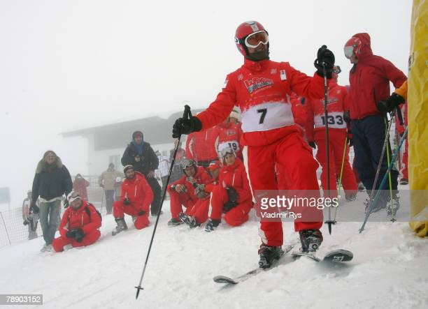 Former Formula One Champion Michael Schumacher of Germany waits his turn to take part on a skiing race during the WROOM F1 Press Meeting on January...