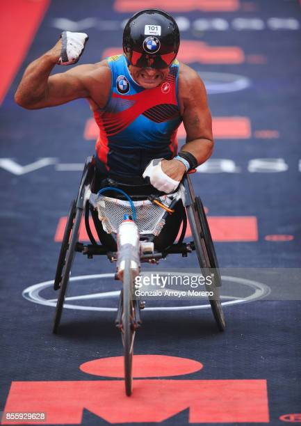 Former Formula One driver and athlete Alex Zanardi arrives at the finish line of the IRONMAN Barcelona on September 30 2017 in Calella Barcelona...