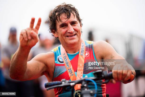 Former Formula One driver and paracyclist Alex Zanardi poses after finishing IRONMAN Barcelona on September 30 2017 in Calella Barcelona province...