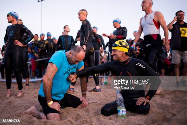 Former Formula One driver and paracyclist Alex Zanardi prepares to dive into the sea to start the swimming course of the IRONMAN Barcelona on...