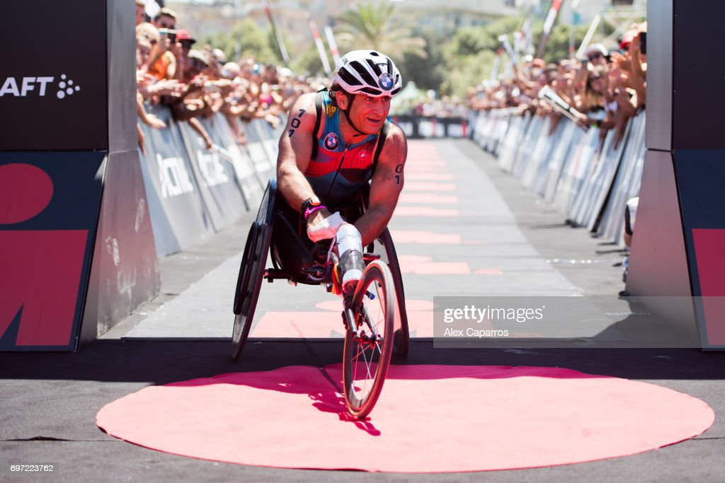 Former Formula One driver and paracyclist Alex Zanardi reacts as he finishes Ironman 70.3 Italy race on June 18, 2017 in Pescara, Italy.
