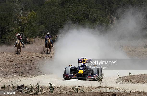 Former Formula One driver David Coulthard of Great Britain drives the Red Bull Show Car at a ranch on August 19, 2011 in Johnson City, Texas.