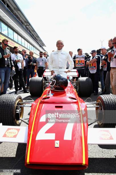 Former Formula One driver Jacky Ickx of Belgium prepares to drive his 1973 Ferrari 312B on track before the Formula One Grand Prix of Belgium at...