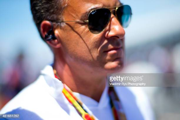 Former Formula One driver Jean Alesi is seen on the grid prior to the Canadian Formula One Grand Prix at Circuit Gilles Villeneuve on June 8 2014 in...