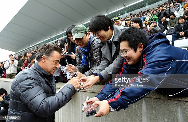 Former Formula One driver Jean Alesi signs autographs for fans during the 2015 Motorsports Fan Thanks Day at Suzuka Circuit on March 7 2015 in Suzuka...