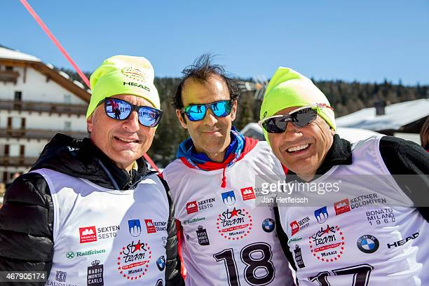 Former Formula One driver Riccardo Patrese Emanuelle Pirro and Claudio Chiappucci pose for a picture during the Star Team for Children Charity Event...