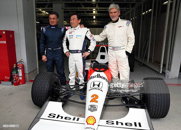 Former Formula One drivers Jean Alesi Satoru Nakajima and Damon Hill pose for photographs with the McLaren Honda MP4/6 during the 2015 Motorsports...