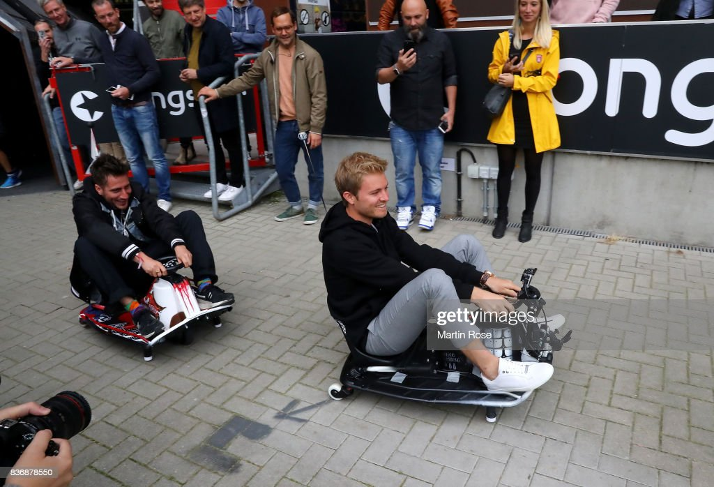 Former Formula One Worldchampion Nico Rosberg (R) of Germany and Michael Fritz, co founder of Viva con Aqua in action during the viva con aqua social e-cart race at Millerntor Stadium on August 22, 2017 in Hamburg, Germany.