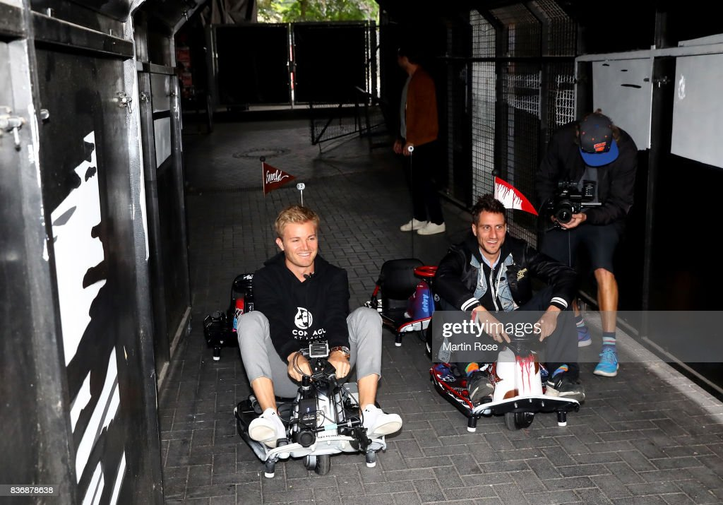 Former Formula One Worldchampion Nico Rosberg (L) of Germany and Michael Fritz, co founder of Viva con Aqua in action during the viva con aqua social e-cart race at Millerntor Stadium on August 22, 2017 in Hamburg, Germany.