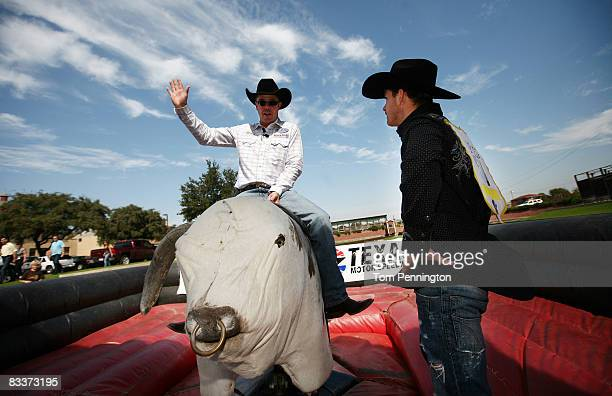 Former fourtime bull riding champion Tuff Hedeman coaches Professional NASCAR driver Scott Speed on the finer points of bull riding in the Fort Worth...