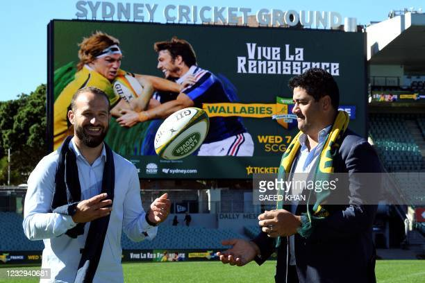 Former France Test star Fred Michalak throws the ball towards Australia's former rugby player Morgan Turinui after a press conference at the Sydney...