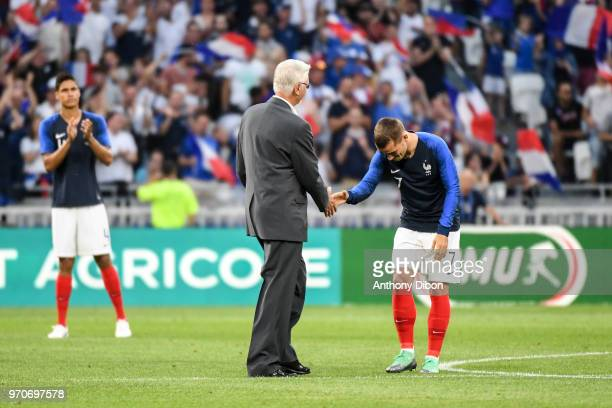 Former France World cup winning coach Aime Jacquet shakes hand with Antoine Griezmann during the International Friendly match between France and...