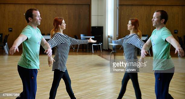 Former freestyle wrestler Alexander Leipold and the professional dancer Oana Andreea Nechiti are reflecting in a mirror during a trainings session...