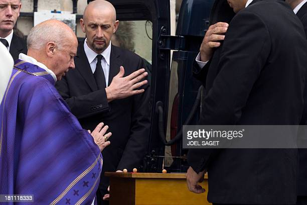 Former French bishop Jacques Gaillot blesses the coffin of French geneticist and philosopher Albert Jacquard, at the end of the funeral ceremony on...