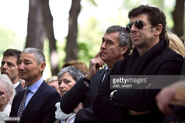 Former French Budget minister Jerome Cahuzac and singer Patrick Bruel stand on June 3, 2013 at the Montmartre cemetery in Paris, during the funeral...