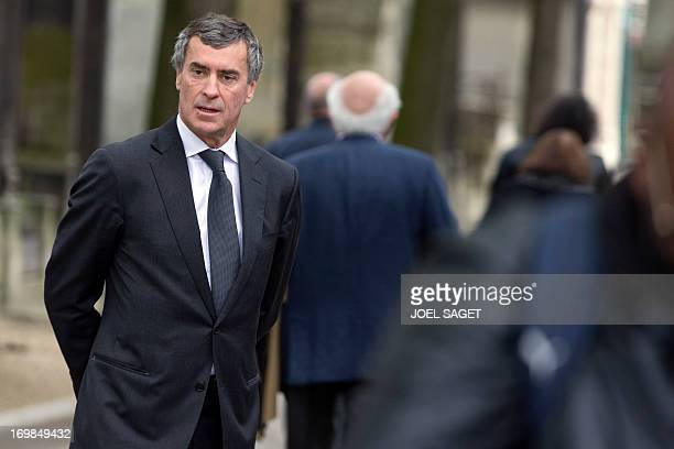 Former French Budget minister Jerome Cahuzac arrives to attend on June 3 2013 at the Montmartre cemetery in Paris the funeral of French University...