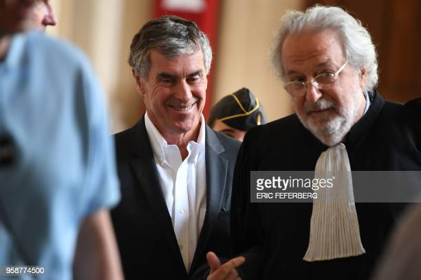 Former French budget minister Jerome Cahuzac who was handed a threeyear jail term in 2016 for tax evasion smiles as he listens to one of his lawyers...