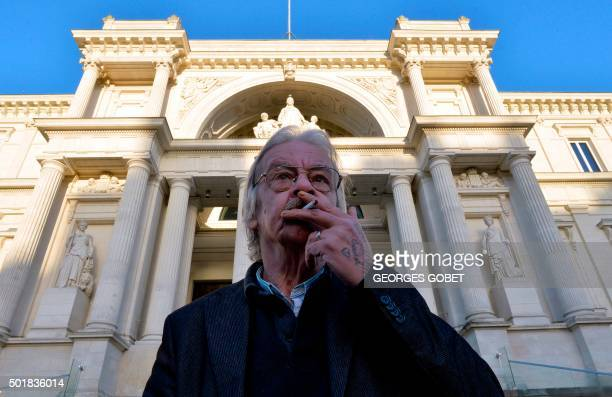 Former French convict Georges Courtois poses in front of the former Nantes courthouse on December 9 2015 Courtois who 30 years ago took hostage a...