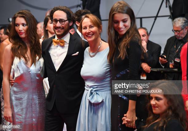 Former French Ecology Minister Segolene Royal her son French lawyer Thomas Hollande and his partner journalist Emilie Broussouloux and guests pose as...