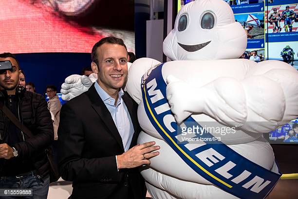 Former French Economy Minister and Founder and Leader of the political movement 'En Marche ' Emmanuel Macron poses next to a Michelin man mascot...