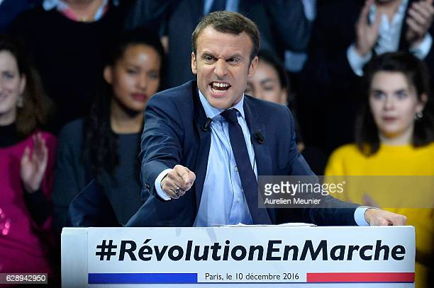 Former French Economy Minister Emmanuel Macron addresses voters during the central political party 'En Marche' meeting on December 10 2016 in Paris...